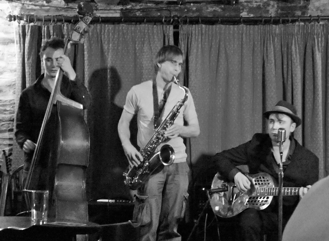 Blues/Jazz trio with Saxophone, Double Bass and Slide Guitar/Vocals at the Royal Oak Pub.