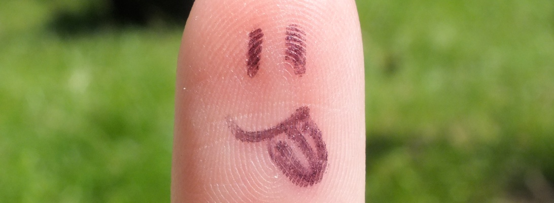 Smiley face on my finger.