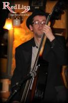 Howard Kahn performing on electric upright bass with Hamer & Isaacs gypsy swing band at The Red Lion Newquay in Cornwall.