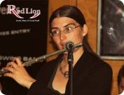 Hannah Sterry playing jazz flute with Hamer & Isaacs gypsy swing band at The Red Lion Newquay in Cornwall.