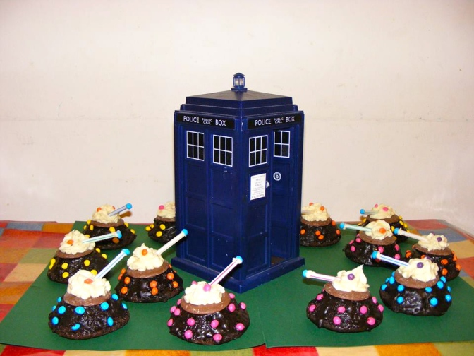 Doctor Who 50th Anniversary Dalek Extermi-cakes surrounding TARDIS.